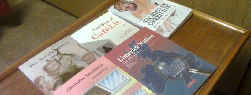 Some of the books my stories have appeared in - image taken by me.