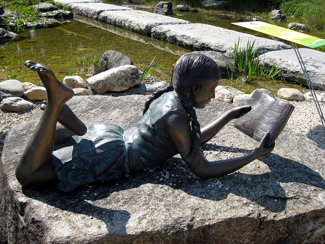 This statue reminds me of myself when I was a lot younger. Okay I wasn't made of stone (I'm still not!) but I did always have my head in a book. (And do so as often as I can now!). Image via Pixabay.