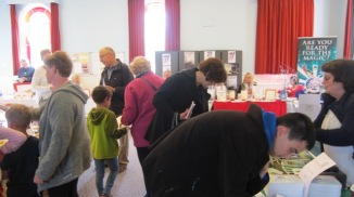 Visitors browsing a wide selection of books