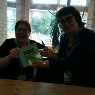 Val Penny and I networking (!) at Swanwick in 2017. Here I've just signed my book for Val. At Swanwick in 2018 I plan to ask Val to sign her book for me! Image taken by Jennifer C Wilson.
