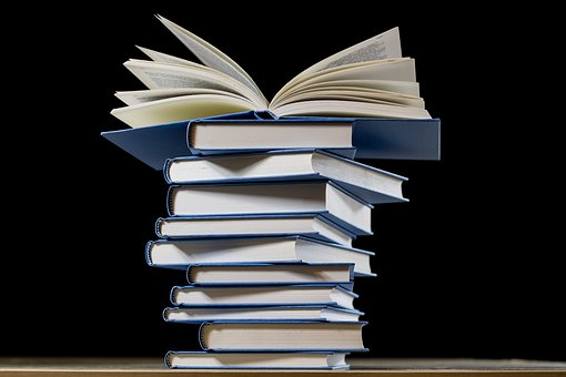 The To Be Read pile - image via Pixabay