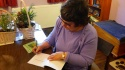 Signing books for a friend. Image by Adrian Symes