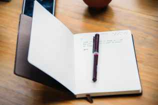 Notebook to hand ready for those story ideas. Image via Pexels.