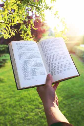 I prefer to sit and read rather than stand! Pexels image.