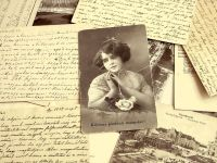 Old diaries and pictures. Image via Pixabay