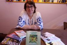 Allison Symes and some of her published works. Image by Adrian Symes