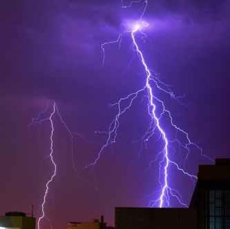 thunder striking a building photo