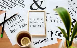 quote calligraphy under cup of lemon tea