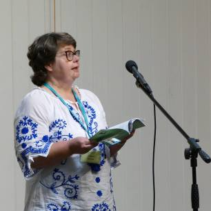 Many thanks to Geoff Parkes for this image of me reading at the Swanwick Writers' Summer School Open Prose Mic Night.