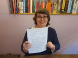 Image of me signing my contract re my contribution to Wendy's book taken by Adrian Symes